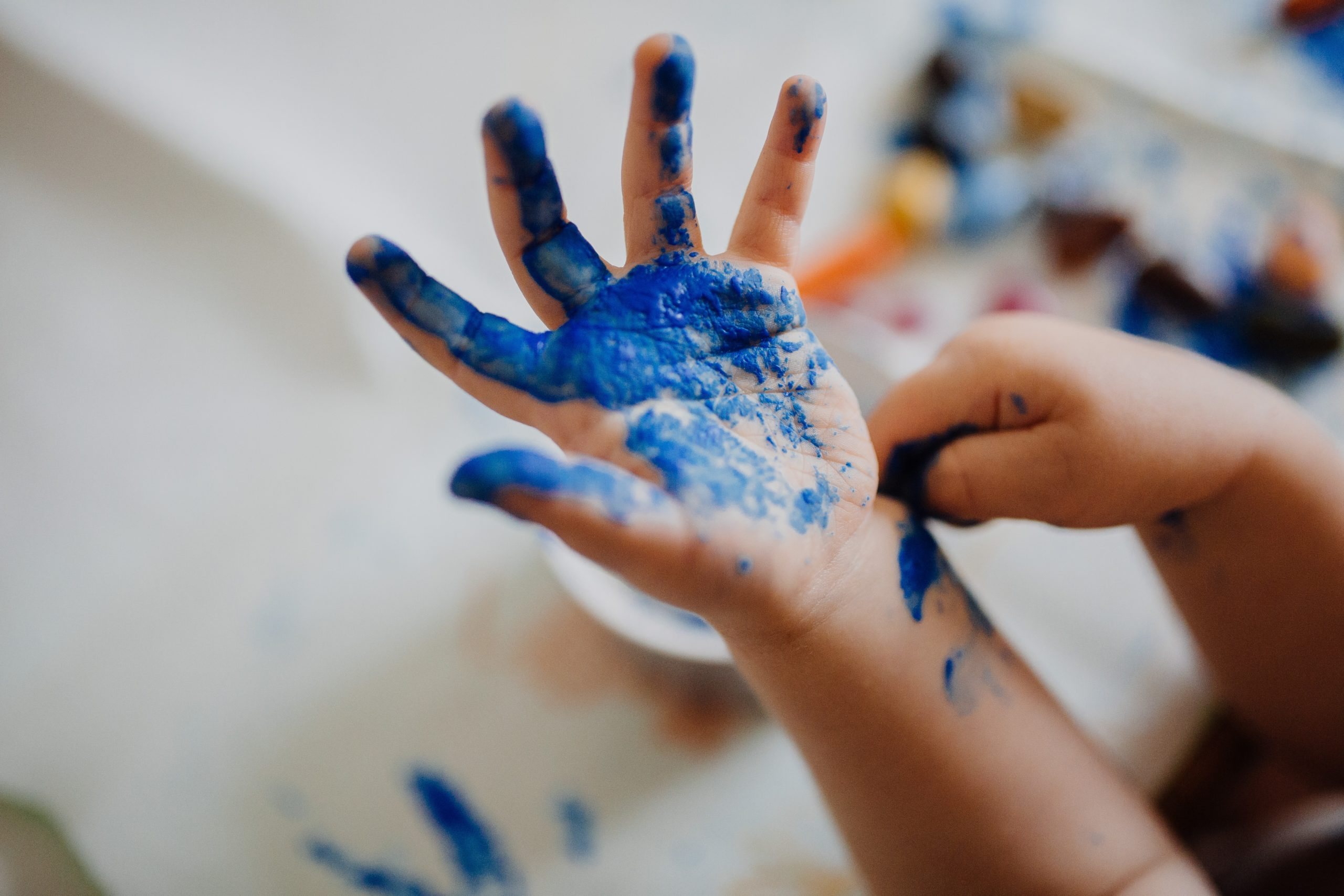 Kids Art Workshop, a kids playing with paint